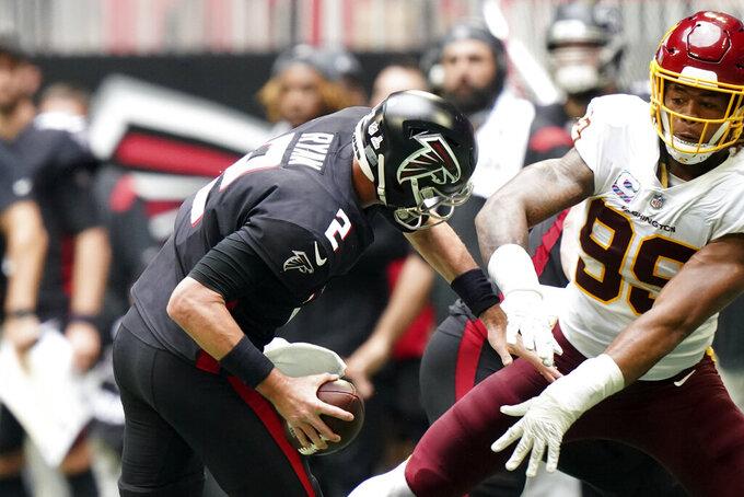 Washington Football Team defensive end Casey Toohill (95) defends against Atlanta Falcons quarterback Matt Ryan (2) during the second half of an NFL football game, Sunday, Oct. 3, 2021, in Atlanta. (AP Photo/Brynn Anderson)