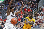 Valparaiso's Daniel Sackey, right, passes around Missouri State's Keandre Cook during the first half of an NCAA college basketball game in the semifinal round of the Missouri Valley Conference men's tournament Saturday, March 7, 2020, in St. Louis. (AP Photo/Jeff Roberson)