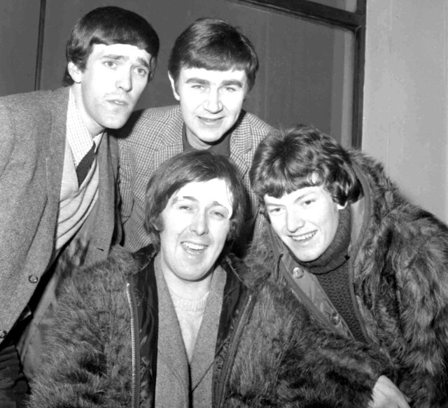 "FILE  - In this Jan. 10, 1966 file photo, members of the band, the Spencer Davis Group, from top left: Muff Winwood, Pete York and Steve Winwood and Spencer Davis, foreground. British guitarist and bandleader Spencer Davis, whose eponymous rock group had 1960s hits including ""Gimme Some Lovin'"" and ""I'm a Man,"" has died at the age of 81. Davis' agent, Bob Birk, said Tuesday, Oct. 20, 2020 that he died in a hospital while being treated for pneumonia.  (AP Photo, File)"