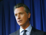 Gov. Gavin Newsom speaks at a news conference Wednesday, Sept. 18, 2019, in Sacramento, Calif. Newsom signed sweeping labor legislation that aims to give wage and benefit protections to rideshare drivers at companies like Uber and Lyft and to workers across other industries.   (AP Photo/Rich Pedroncelli)