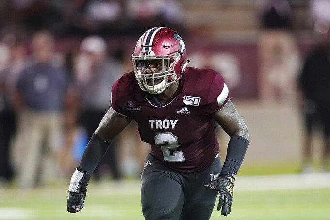 FILE - Troy linebacker Carlton Martial (2) plays during an NCAA football game in Troy, Ala., in this Saturday, Sept. 14, 2019, file photo. Martial is the preseason defensive player of the year in the Sun Belt Conference after making a nation-leading 113 tackles for a team that finished 5-6. (AP Photo/Marvin Gentry, File)