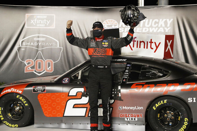 Austin Cindric celebrates his win after a NASCAR Xfinity Series auto race Thursday, July 9, 2020, in Sparta, Ky. (AP Photo/Mark Humphrey)