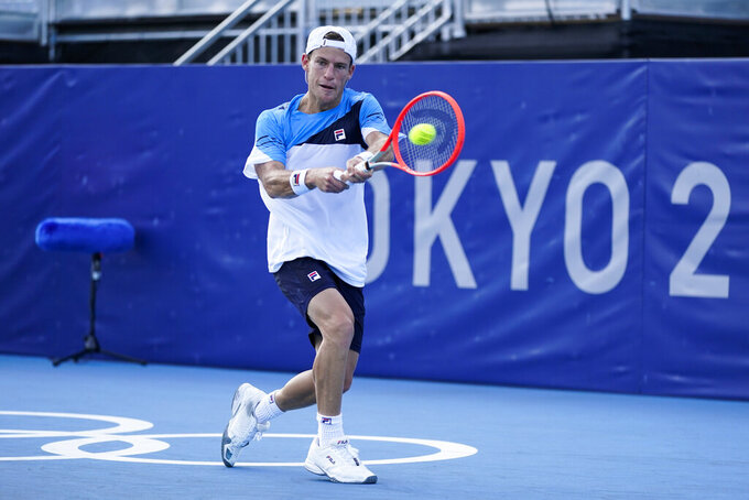 Diego Schwartzman, of Argentina, returns to Juan Pablo Varillas, of Peru, during the tennis competition at the 2020 Summer Olympics, Sunday, July 25, 2021, in Tokyo, Japan. (AP Photo/Patrick Semansky)