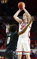 Oklahoma's Brady Manek (35) shoots over Vanderbilt's Saben Lee (0) during the first half of an NCAA college basketball game in Norman, Okla., Saturday, Jan. 26, 2019. (Nate Billings/The Oklahoman via AP)