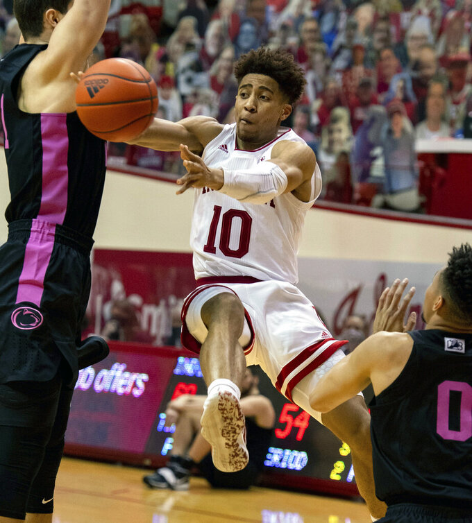 Indiana guard Rob Phinisee (10) passes the ball off to a teammate during the second half of an NCAA college basketball game against Penn State, Wednesday, Dec. 30, 2020, in Bloomington, Ind. Indiana won 87-85 in overtime. (AP Photo/Doug McSchooler)