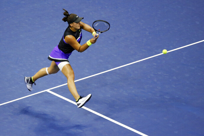 Bianca Andreescu, of Canada, returns a shot to Taylor Townsend, of the United States, during the fourth round of the U.S. Open tennis tournament, Monday, Sept. 2, 2019, in New York. (AP Photo/Jason DeCrow)