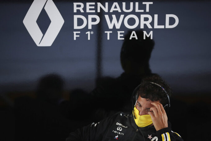 Renault driver Daniel Ricciardo of Australia speaks with journalists prior to the Formula One Grand Prix at the Spa-Francorchamps racetrack in Spa, Belgium Thursday, Aug. 27, 2020. (AP Photo/Francisco Seco)