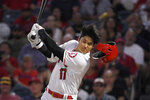 Los Angeles Angels designated hitter Shohei Ohtani, of Japan, loses his helmet as he swings for a strike during the first inning of a baseball game against the Boston Red Sox, Friday, Aug. 30, 2019, in Anaheim, Calif. (AP Photo/Mark J. Terrill)