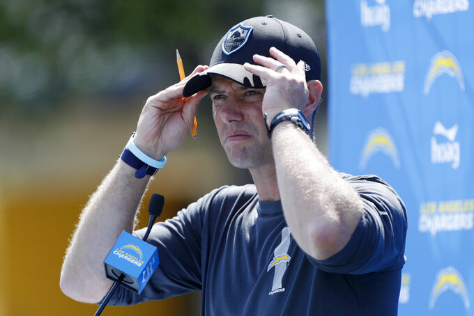 Los Angeles Chargers head coach Brandon Staley adjusts his cap during a news conference after an NFL football team practice in Costa Mesa, Calif., Thursday, Aug. 12, 2021. (AP Photo/Alex Gallardo)