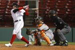 Boston Red Sox's Michael Chavis grounds into a double play with the bases loaded, in front of Baltimore Orioles catcher Pedro Severino during the fifth inning of a baseball game Tuesday, Sept. 22, 2020, in Boston. (AP Photo/Michael Dwyer)