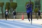 In this Feb. 12, 2020 photo, Joseph Akoon Akoon, right, and other of the South Sudan team practice together during training for the Tokyo 2020 Olympics and Paralympics in Maebashi, Gunma Prefecture, north of Tokyo. (AP Photo/Eugene Hoshiko)