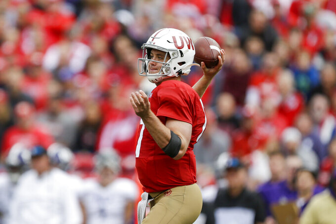 Wisconsin quarterback Jack Coan (17) looks to pass against against Northwestern during the first half of an NCAA college football game Saturday, Sept. 28, 2019, in Madison, Wis. (AP Photo/Andy Manis)