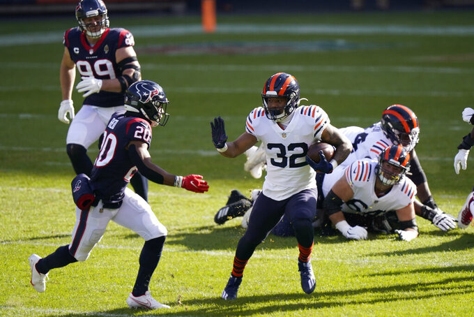 Chicago Bears' David Montgomery (32) runs past Houston Texans' Justin Reid (20) for a touchdown during the first half of an NFL football game, Sunday, Dec. 13, 2020, in Chicago. (AP Photo/Nam Y. Huh)