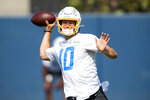 Los Angeles Chargers quarterback Justin Herbert (10) throws a pass during an NFL football practice Wednesday, June 16, 2021, in Costa Mesa, Calif. (AP Photo/Kyusung Gong)