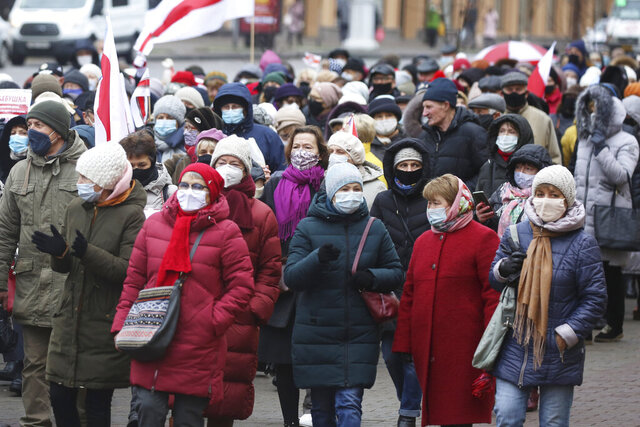 Belarusian pensioners wearing face masks to protect against coronavirus attend an opposition rally to protest the official presidential election results in Minsk, Belarus, Monday, Nov. 23, 2020.  Large crowds of retirees have protested in the Belarusian capital to demand the resignation of the country's authoritarian leader who won his sixth term in office in a disputed election. Over 2,000 pensioners marched down a central avenue in Minsk in what has turned into a regular Monday rally. (AP Photo)