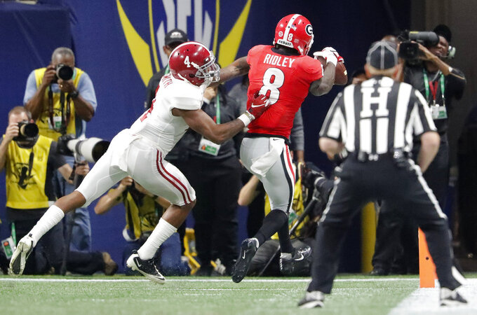 Georgia wide receiver Riley Ridley (8) makes a touchdown catch against Alabama defensive back Saivion Smith (4) during the second half of the Southeastern Conference championship NCAA college football game, Saturday, Dec. 1, 2018, in Atlanta. (AP Photo/John Bazemore)