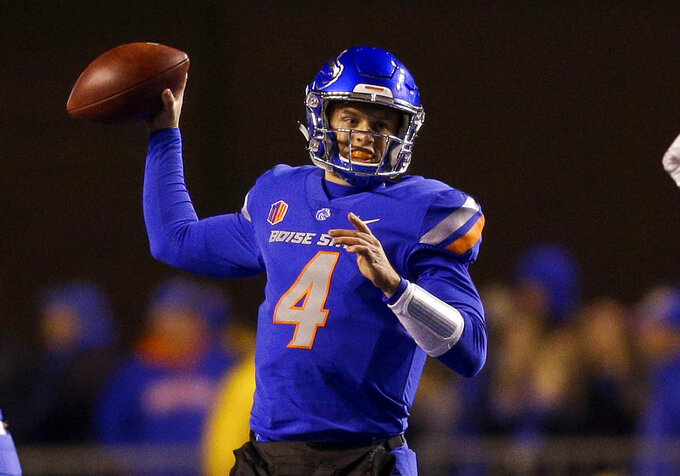 FILE - In this Nov. 9, 2018, file photo, Boise State quarterback Brett Rypien (4) throws the ball against Fresno State in the first half of an NCAA college football game in Boise, Idaho. Rypien is the active FBS career leader with 13,581 yards passing, a Mountain West record. He also shares the rare distinction with Kellen Moore, now the quarterbacks coach for the Dallas Cowboys, as a four-year starter for the Broncos. (AP Photo/Steve Conner, File)