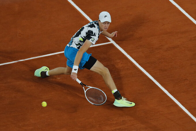 Italy's Jannik Sinner plays a shot against Belgium's David Goffin in the first round match of the French Open tennis tournament at the Roland Garros stadium in Paris, France, Sunday, Sept. 27, 2020. (AP Photo/Christophe Ena)
