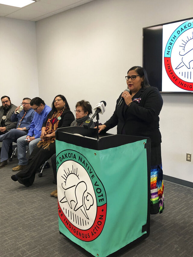 Nicole Donaghy, executive director of North Dakota Native Vote, addresses a crowd of Native American activists and others on Wednesday Feb. 5, 2020, in Bismarck, N.D. The group has launched its voter awareness and turnout drive in an effort to build on work begun years ago when American Indians challenged the state's voter identification requirements as an unfair burden and an attempt to suppress the Native American vote. (AP Photo/James MacPherson)
