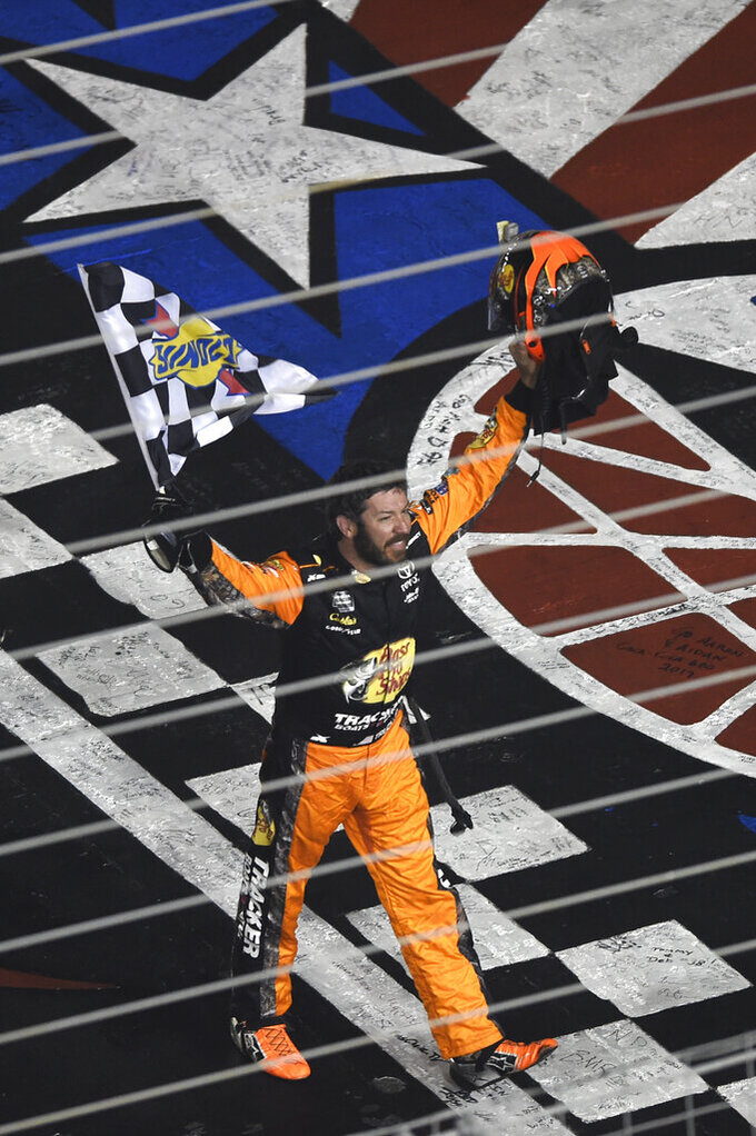 Martin Truex Jr. celebrates after winning the NASCAR Cup Series auto race at Charlotte Motor Speedway in Concord, N.C., Sunday, May 26, 2019. (AP Photo/Mike McCarn)