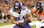 FILE - In this Aug. 11, 2018, file photo, Minnesota Vikings wide receiver Chad Beebe, left, scores past Denver Broncos cornerback C.J. Smith during the second half in an NFL football preseason game in Denver. Beebe, Jordan Taylor, Laquon Treadwell and Brandon Zylstra are among the leading candidates to emerge as the No. 3 wide receiver for the Vikings. Even with stars Adam Thielen and Stefon Diggs established at that position, quarterback Kirk Cousins needs another go-to target. (AP Photo/Mark Reis, File)