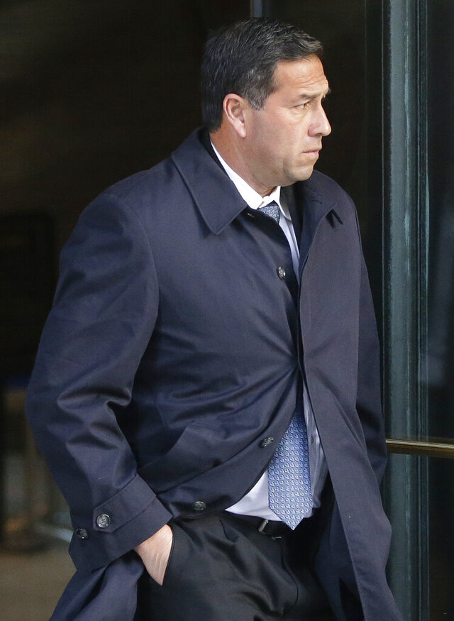 FILE - In this March 25, 2019 file photo, Jorge Salcedo, former University of California at Los Angeles men's soccer coach, departs federal court in Boston, after facing charges in a nationwide college admissions bribery scandal. Salcedo will plead guilty to taking bribes as part of the college admissions cheating scheme, federal prosecutors said Tuesday, April 21, 2020. The former UCLA soccer coach is to admit to getting bribes in exchange for helping get one male and one female student into the school as fake soccer recruits. (AP Photo/Steven Senne, File)