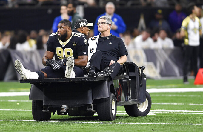FILE - In this Jan. 13, 2019, file photo, New Orleans Saints defensive tackle Sheldon Rankins (98) leaves the field after an injury in the first half of an NFL divisional playoff football game against the Philadelphia Eagles in New Orleans. Rankins has returned to practice for the first time since tearing his Achilles tendon in New Orleans' divisional round playoff victory over Philadelphia last January. Saints coach Sean Payton says he does not think it is realistic that Rankins would play in the regular season opener. (AP Photo/Bill Feig, File)