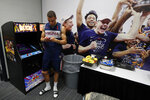 Virginia's Francesco Badocchi texts during a news conference in the locker room for the championship of the Final Four NCAA college basketball tournament, Sunday, April 7, 2019, in Minneapolis. Virginia will play Texas Tech on Monday for the national championship. (AP Photo/Charlie Neibergall)