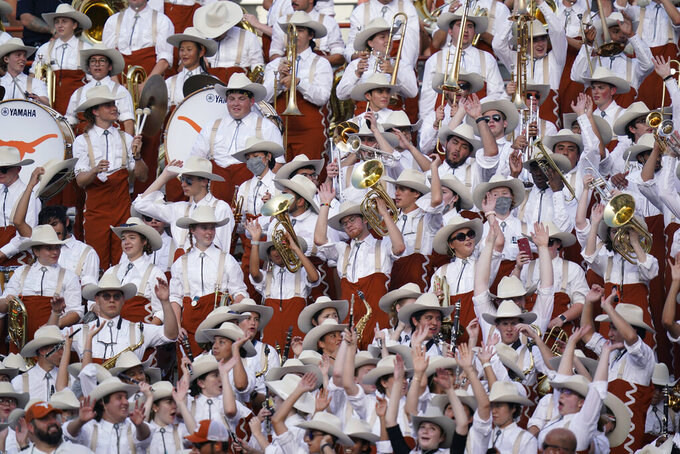 Texas band members cheer during during the second half of the team's NCAA college football game against Louisiana-Lafayette, Saturday, Sept. 4, 2021, in Austin, Texas. (AP Photo/Eric Gay)