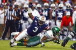Tulane running back Amare Jones is tackled for a loss by Auburn defensive end Marlon Davidson (3) during the first quarter of an NCAA college football game Saturday, Sept. 7, 2019, in Auburn, Ala. (AP Photo/Butch Dill)