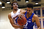BYU forward Yoeli Childs, right, and Pepperdine forward Kameron Edwards (20) struggle for the ball during the second half of an NCAA college basketball game Saturday, Feb. 29, 2020, in Malibu, Calif. (AP Photo/Ringo H.W. Chiu)
