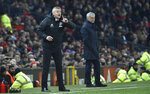 Manchester United's manager Ole Gunnar Solskjaer, left, gives instructions from the side line as Tottenham's manager Jose Mourinho looks on during the English Premier League soccer match between Manchester United and Tottenham Hotspur at Old Trafford in Manchester, England, Wednesday, Dec. 4, 2019. (AP Photo/Rui Vieira)