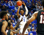Kentucky's Immanuel Quickley prepares to shoot a three-point basket while defended by Lamar's V.J. Holmes during the first half of an NCAA college basketball game in Lexington, Ky., Sunday, Nov. 24, 2019. (AP Photo/James Crisp)