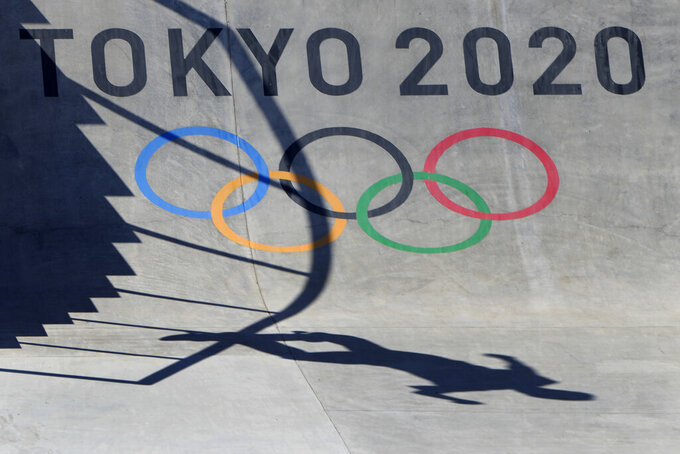 Yuto Horigome, of Japan, trains during a street skateboarding practice session at the 2020 Summer Olympics, Wednesday, July 21, 2021, in Tokyo, Japan. (AP Photo/Gregory Bull)