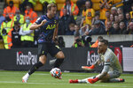 Tottenham's Harry Kane has a shot on goal during the English Premier League soccer match between Wolverhampton Wanderers and Tottenham Hotspur at Molineux stadium in Wolverhampton, England, Sunday, Aug. 22, 2021. (AP Photo/Rui Vieira)