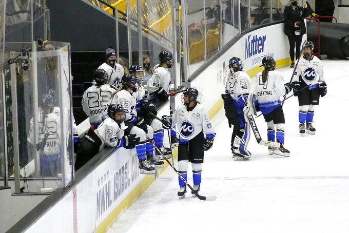 Minnesota Whitecaps players watch from the bench area after losing to the Boston Pride in the NWHL Isobel Cup championship hockey game Saturday, March 27, 2021, in Boston. (AP Photo/Mary Schwalm)