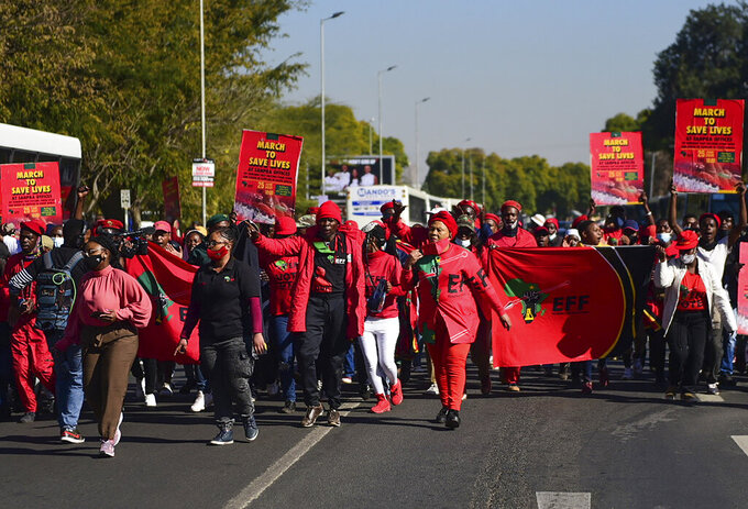 Members of the Economic Freedom Fighters stage a protest march in Pretoria, South Africa, Friday June 25, 2021, demanding that vaccines from China and Russia be included in the country's vaccine rollout program. South Africa's third wave of COVID-19 infections is overwhelming the health system in Gauteng, the country's most populous province that is now running out of beds to treat patients. (AP Photo Let Pretorius)