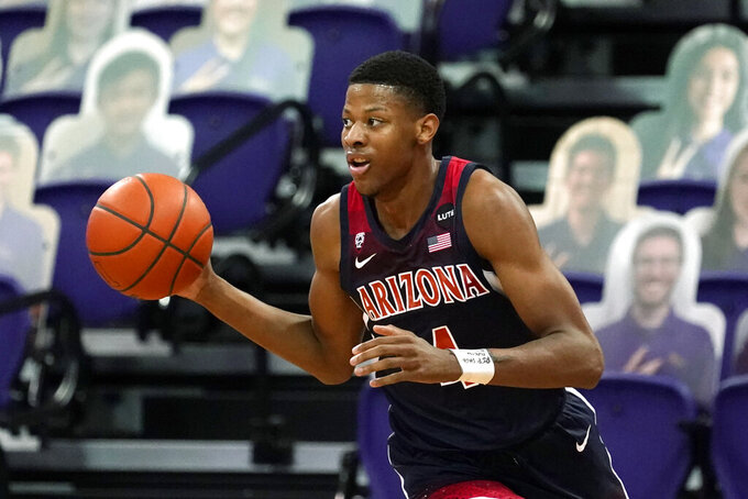 Arizona's Dalen Terry dribbles brings the ball up during the first half of the team's NCAA college basketball game against Washington on Thursday, Dec. 31, 2020, in Seattle. (AP Photo/Elaine Thompson)