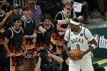 Milwaukee Bucks' Bobby Portis pumps up the crowd during the second half of Game 5 of the team's NBA Eastern Conference final against the Atlanta Hawks on Thursday, July 1, 2021, in Milwaukee. (AP Photo/Aaron Gash)