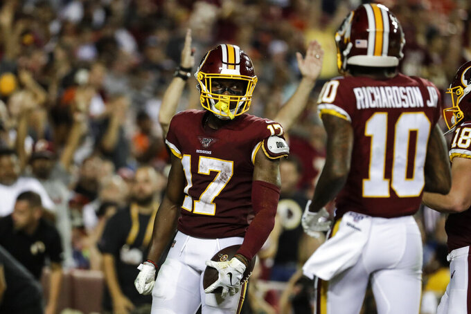 Washington Redskins wide receiver Terry McLaurin (17) celebrates his touchdown with Paul Richardson (10) during the second half of an NFL football game against the Chicago Bears, Monday, Sept. 23, 2019, in Landover, Md. (AP Photo/Julio Cortez)