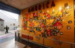 A lone security officer walks past a map of America in the main terminal of Denver International Airport as it gets back to life with the easing of restrictions to check the spread of the new coronavirus Wednesday, May 13, 2020, in Denver. (AP Photo/David Zalubowski)