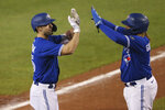 Toronto Blue Jays Randal Grichuk,left, celebrates his three-run home run with Vladimir Guerrero Jr. during the seventh inning of the team's baseball game against the Baltimore Orioles, Saturday, Sept. 26, 2020, in Buffalo, N.Y. (AP Photo/Jeffrey T. Barnes)