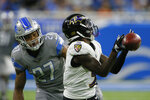 Baltimore Ravens wide receiver Marquise Brown (5) can't catch a pass as Detroit Lions defensive back Bobby Price (27) defends in the first half of an NFL football game in Detroit, Sunday, Sept. 26, 2021. (AP Photo/Duane Burleson)