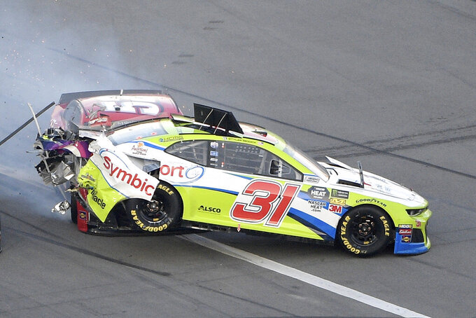 Tyler Reddick (31) is hit from behind by Cody Ware (52) during a NASCAR Daytona 500 auto race at Daytona International Speedway Sunday, Feb. 17, 2019, in Daytona Beach, Fla. (AP Photo/Phelan M. Ebenhack)