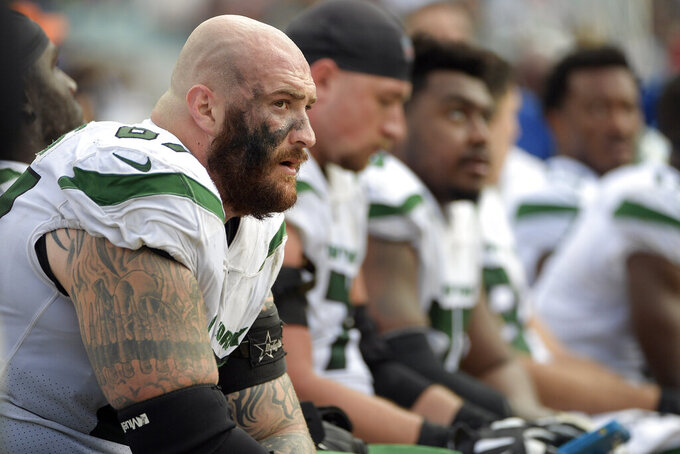 FILE - In this Oct. 27, 2019, file photo, New York Jets offensive guard Brian Winters, left, sits on the bench with teammates during the final moments of an NFL football game against the Jacksonville Jaguars in Jacksonville, Fla. The Buffalo Bills signed offensive guard Brian Winters on Thursday, Aug. 6, 2020, five days after the seventh-year player was released by the New York Jets. (AP Photo/Phelan M. Ebenhack, File)
