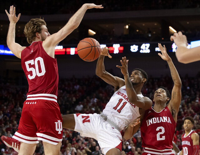 Nebraska guard Dachon Burke Jr. (11) loses the ball as he is defended by Indiana's Joey Brunk (50) and Armaan Franklin (2) in the second half of an NCAA college basketball game Saturday, Jan. 18, 2020, in Lincoln, Neb. (Francis Gardler/Lincoln Journal Star via AP)