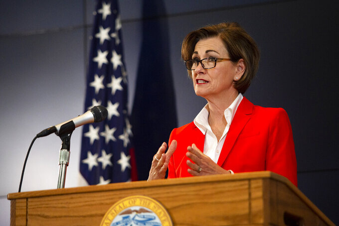 Iowa Governor Kim Reynolds holds a news conference on COVID-19 at the State Emergency Operations Center in Johnston, Iowa, on Tuesday, May 19, 2020. (Olivia Sun/The Des Moines Register via AP, Pool)