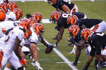 Cincinnati Bengals players line up at the line of scrimmage during an NFL football team scrimmage in Cincinnati, Sunday, Aug. 30, 2020. (AP Photo/Bryan Woolston)