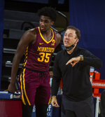 Minnesota forward Isaiah Ihnen (35) stands next to head coach Richard Pitino courtside in the first half of an NCAA college basketball game against Michigan at Crisler Center in Ann Arbor, Mich., Wednesday, Jan. 6, 2021. (AP Photo/Tony Ding)