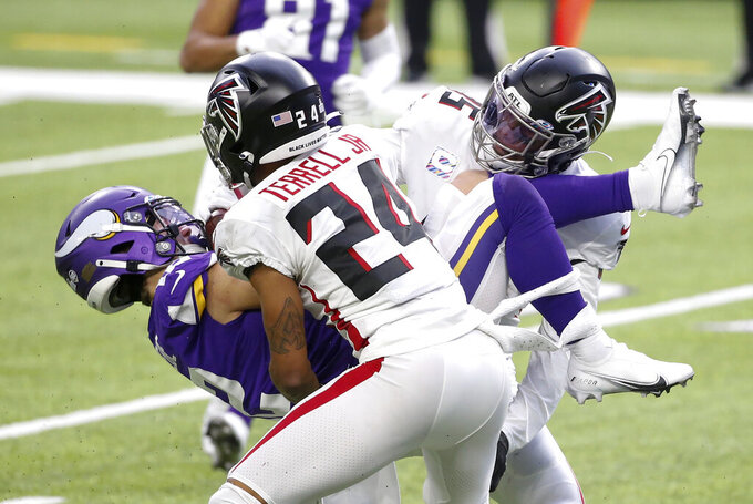 Minnesota Vikings wide receiver Chad Beebe, left, is tackled by Atlanta Falcons defenders A.J. Terrell (24) and Deion Jones, right, after catching a pass during the second half of an NFL football game, Sunday, Oct. 18, 2020, in Minneapolis. (AP Photo/Bruce Kluckhohn)